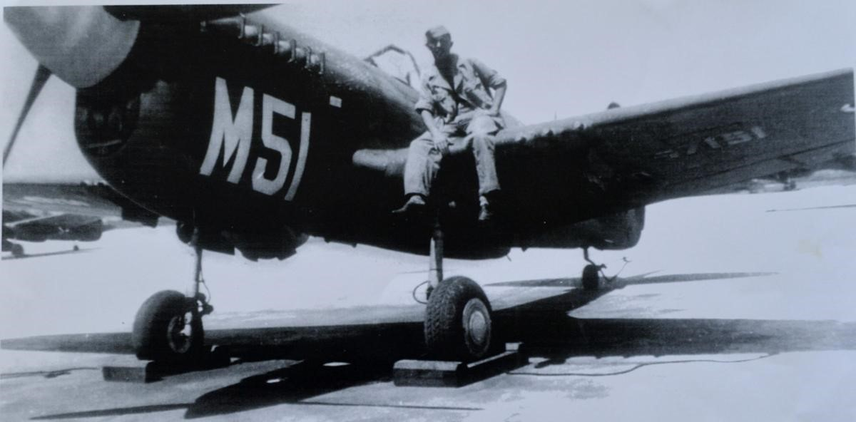 An airman sits on the wing of a Curtis P-40 Warhawk fighter plane at the Punta Gorda Army Airfield. After it was developed, the North American P-51 Mustang replaced the older P-40s and became one of the most legendary planes of World War II. PHOTO PROVIDED BY GUSSIE BAKER