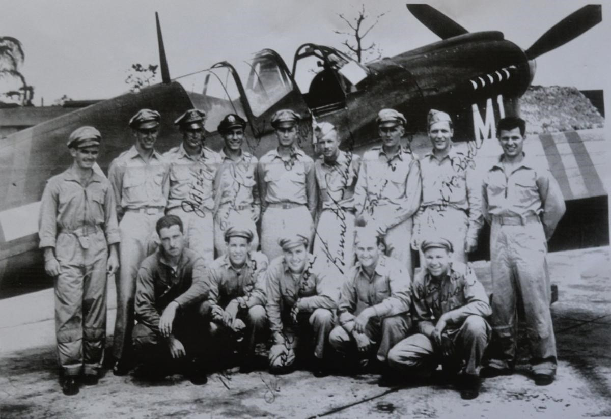 A group of pilots pose with a trainer during their stay at Punta Gorda Airfield during World War II. Photo provided by Gussie Baker