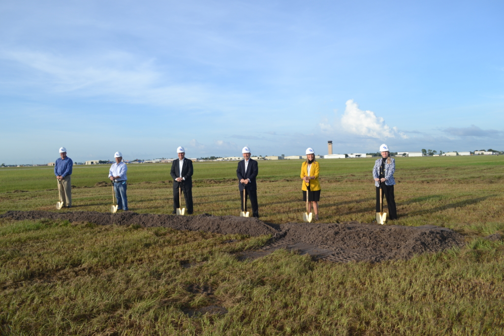 (L to R) PGD's CEO James Parish; Charlotte County Airport Authority Commissioners Robert Hancik, Paul Andrews, James Herston, Board Chair Pamella Seay and Kathleen Coppola.